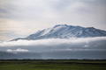 Top of Hekla volcano, Iceland towering over clouds - PhotoDune Item for Sale