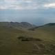 Baikal region. Dirt road on Tazheranskaya steppe near the stone rocks, called the Valley of the - PhotoDune Item for Sale