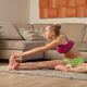 fit woman doing fitness exercise at home - PhotoDune Item for Sale