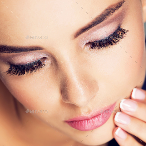 portrait of a woman with  long black eyelashes - Stock Photo - Images