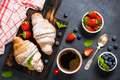 Croissant with fresh berries and cup of coffee on black - PhotoDune Item for Sale