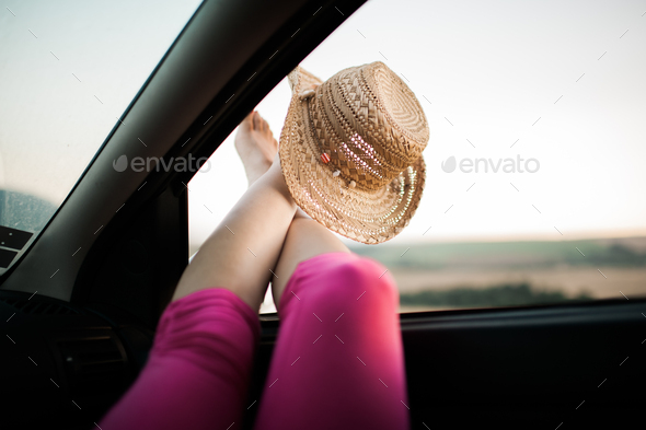 Legs sticking out of car window - Stock Photo - Images