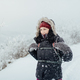 Smiling woman dressed warm enjoying a walk in snowy country - PhotoDune Item for Sale