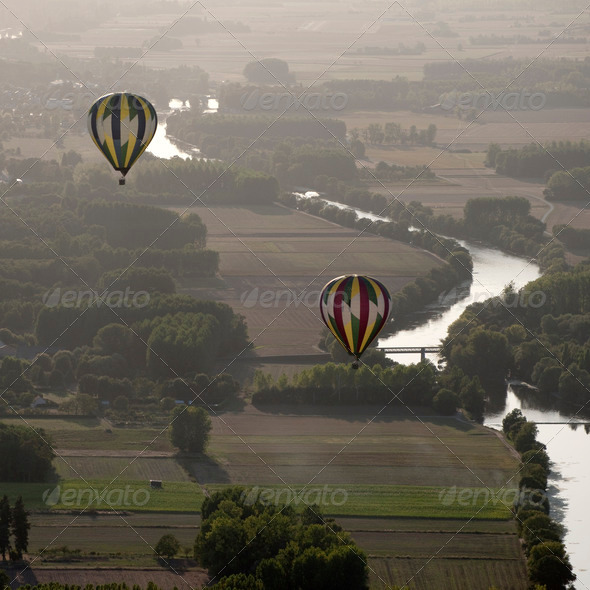 Hot air balloons over the river Cher in France - Stock Photo - Images