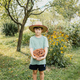 Boy holding basket of hazelnuts - PhotoDune Item for Sale