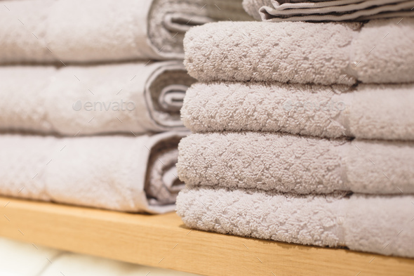 Shelves with towels stacks in shop. Hygge or another scandinavian style - Stock Photo - Images