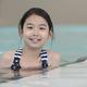 Asian teenager girl in swimming pool - PhotoDune Item for Sale