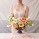 Woman holding vase full of flowers. - PhotoDune Item for Sale