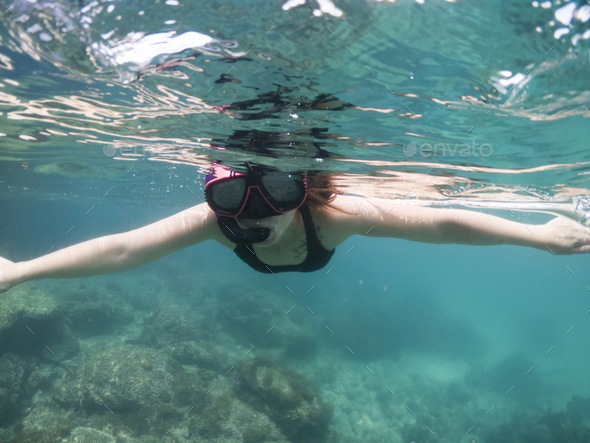 Underwater portrait of a woman snorkeling in tropical sea. - Stock Photo - Images