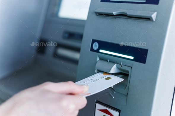 Person insert card to automated teller machine. Cashing non-cash money by individual. - Stock Photo - Images