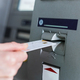 Person insert card to automated teller machine. Cashing non-cash money by individual. - PhotoDune Item for Sale