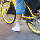 Woman on bicycle in city. Close-up view - PhotoDune Item for Sale