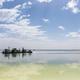 salt mining ship and blue sky reflection in qarhan salt lake - PhotoDune Item for Sale