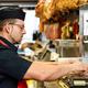 Male butcher cutting ham bones in a cutting machine - PhotoDune Item for Sale