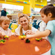 Mother with little children playing in kids store - PhotoDune Item for Sale