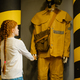 Female child looks on fireman mannequin, playroom - PhotoDune Item for Sale