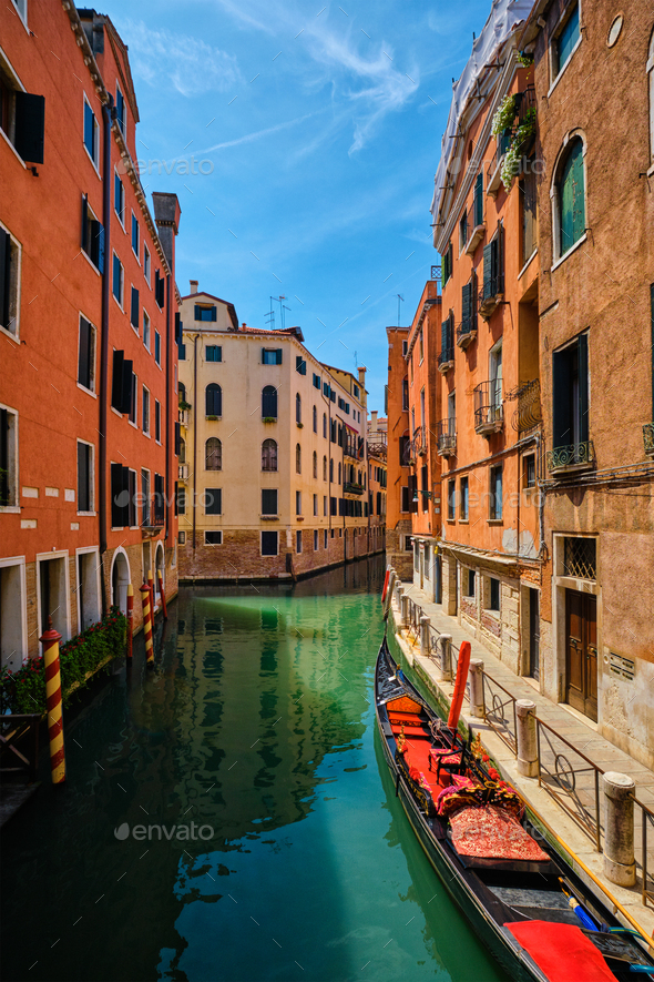 Narrow canal with gondola in Venice, Italy - Stock Photo - Images