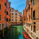Narrow canal with gondola in Venice, Italy - PhotoDune Item for Sale
