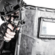 SWAT team fighter aiming pistol from behind shield - PhotoDune Item for Sale