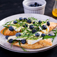 Bruschetta. Toast crostini with fresh berries blueberry and honey, brie cheese, arugula. - PhotoDune Item for Sale