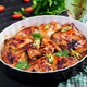 Baked chicken wings in the Asian style on baking dish. - PhotoDune Item for Sale