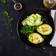 Avocado baked with egg and fresh salad. Vegetarian dish. Top view, overhead.  Ketogenic diet - PhotoDune Item for Sale