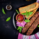 Kebab adana,  lamb and beef and toasts with pesto sauce. Top view - PhotoDune Item for Sale