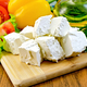 Feta cheese on the board with vegetables and salad - PhotoDune Item for Sale
