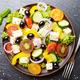 Top view at Mediterranean diet dish greek salad on slate tray - PhotoDune Item for Sale