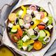 Top view at Mediterranean diet dish greek salad on vintage metal - PhotoDune Item for Sale