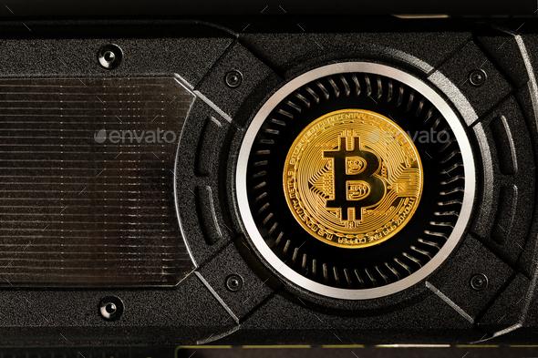 Gold bitcoin on crypto mining GPU computer hardware - Stock Photo - Images