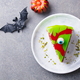 Halloween Cake on a White Plate with Holiday Table Decoration. Grey Background. - PhotoDune Item for Sale