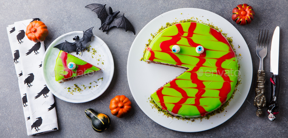 Halloween Cake on a White Plate with Holiday Table Decoration. Grey Background. Top View. - Stock Photo - Images