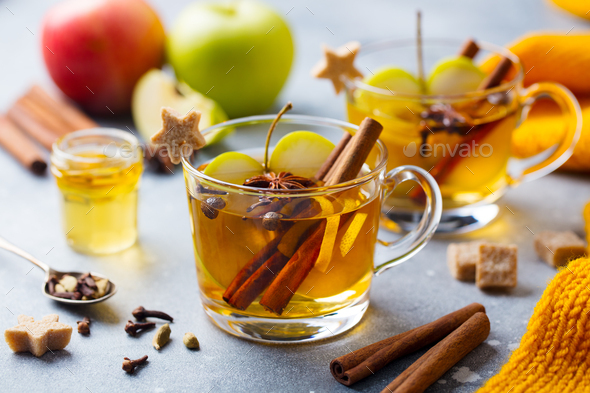 Apple Mulled Cider with Spices in Glass Cup. Grey Background. - Stock Photo - Images