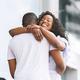 Happy african woman embracing her loving boyfriend - PhotoDune Item for Sale