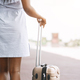 Black millennial woman standing with luggage at airport - PhotoDune Item for Sale