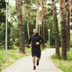 Healthy Lifestyle. Sporty Guy Jogging In Park During Morning Workout - PhotoDune Item for Sale