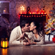 Joyful couple near christmas tree and fireplace in romantic lighting - PhotoDune Item for Sale