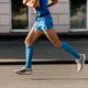 athlete runner in blue compression socks - PhotoDune Item for Sale