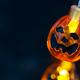 Halloween pumpkin orange Jack O'Lantern smiling face with as candle light lit on grunge - PhotoDune Item for Sale