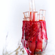 Halloween bloody glass with test tubes of tomato juice. Party drinks on white background - PhotoDune Item for Sale