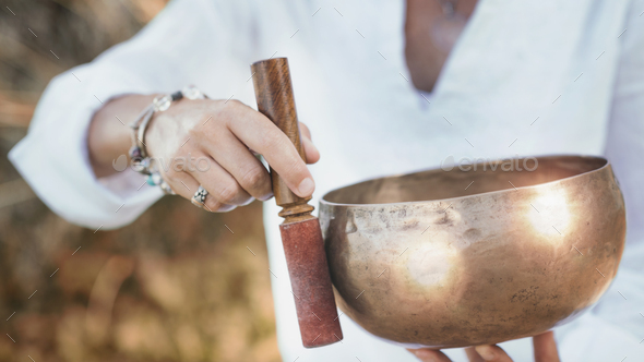 Sound Therapy with Tibetan Singing Bowl - Stock Photo - Images