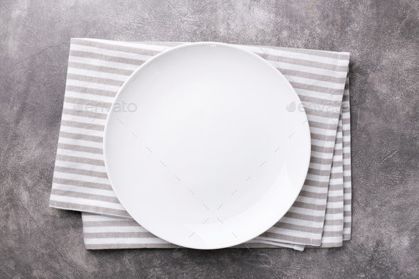 Empty Plate on Linen Napkin on Gray Stone Table. - Stock Photo - Images