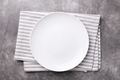 Empty Plate on Linen Napkin on Gray Stone Table. - PhotoDune Item for Sale