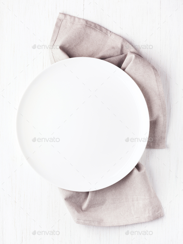 Empty Plate on Linen Napkin on White Table. - Stock Photo - Images