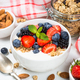 Greek yogurt granola with fresh berries on white table - PhotoDune Item for Sale