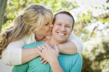 Young Attractive Loving Couple Hugging in the Park.