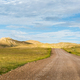 gravel dirt road on nature reserve - PhotoDune Item for Sale