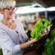 Picture of mature woman at marketplace buying vegetables - PhotoDune Item for Sale