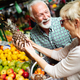 Mature shopping couple with basket on the market. Healthy diet - PhotoDune Item for Sale